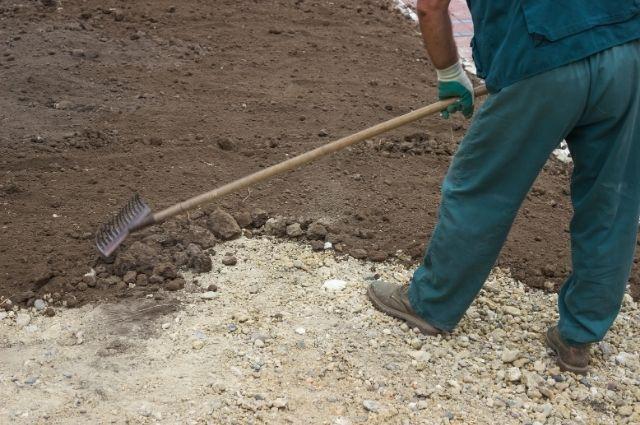 grading a yard using a rake